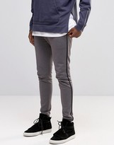 Asos Jersey Skinny Joggers With Stripe In Gray