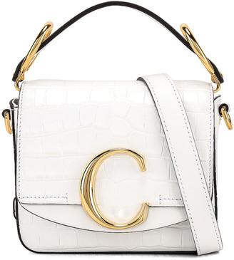 Chloé Mini C Embossed Croc Crossbody Bag in Brilliant White | FWRD