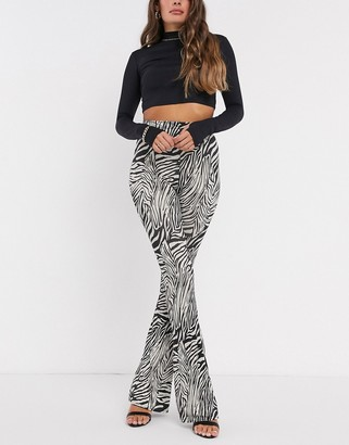 New Girl Order high waisted flared trousers in animal
