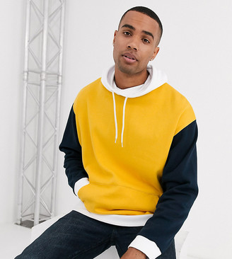 Asos DESIGN Tall oversized hoodie with funnel neck and color blocking in navy yellow & white