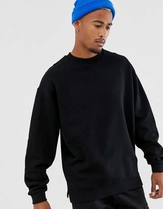 Asos Design DESIGN oversized sweatshirt in black with split hem