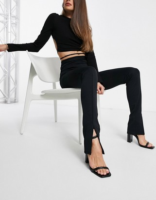 Flounce London high waist tailored stretch pants with front slit in black