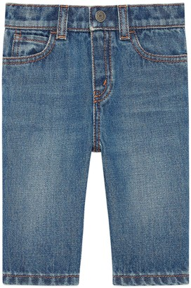 Gucci Baby denim trousers with embroidered label