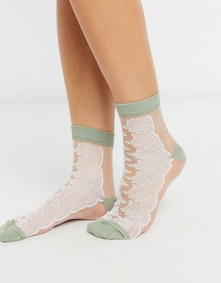 Asos DESIGN sheer mesh lace detail sock with green heel and toe