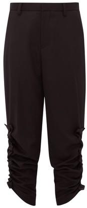 Noir Kei Ninomiya Ruched-cuff Cropped Wool Trousers - Womens - Black