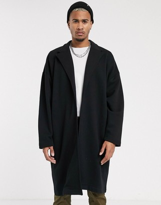 ASOS DESIGN extreme oversized duster jacket in black with back taping