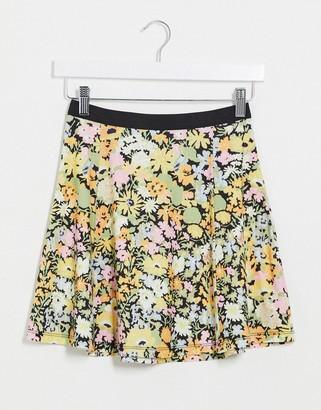 ASOS DESIGN elasticated waist flippy floral print mini skirt