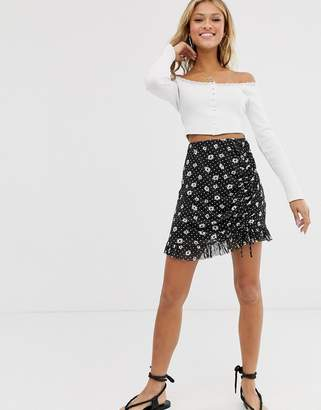 Miss Selfridge mini skirt with ruched side in floral print-Black