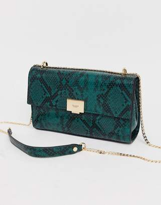 Dune shoulder bag in green snake with chain hardware