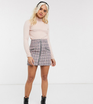 Asos DESIGN Petite boucle mini skirt with zip front and pockets