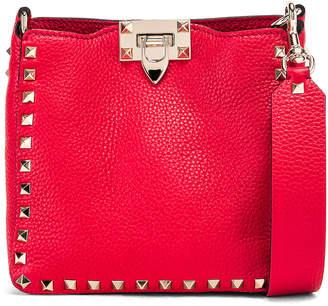 Valentino Rockstud Messenger Bag in Red | FWRD