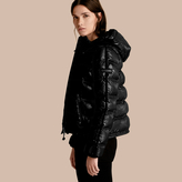 Burberry Glossy Hooded Puffer Jacket with Sporty Detailing