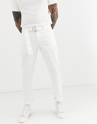 Asos Design DESIGN stretch slim jeans in white with self belt