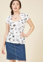 MC57447 Well look at you, feeling fabulous and fashionable in your new white top! The way you're walking in the dramatic angular neckline and black, sci-fi-themed print of this short-sleeved shirt shows that you've got confidence to spare and fierce attitude aple