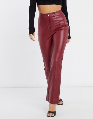 NA-KD faux leather trousers in burgundy