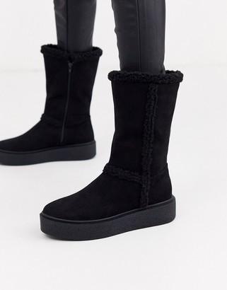 ASOS DESIGN Aquarius faux fur flat boots in black