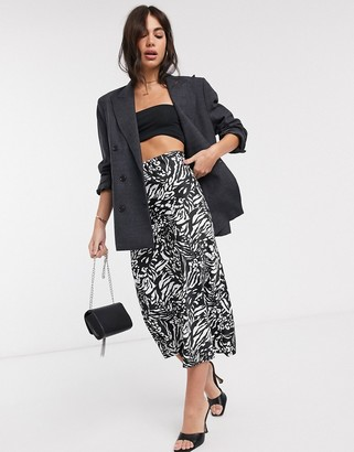ASOS DESIGN bias cut satin slip midi skirt in mono animal print