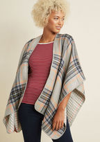 Snuggle up by the fire for s'mores and stories while enwrapped in this rustic, reversible shawl. Featuring a beige, red, and emerald plaid print on one side, with a soothing navy hue on the other, this comfy cover will morph to fit your mood as the relaxi