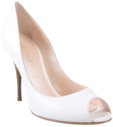 Peep toe shoes with horn heel