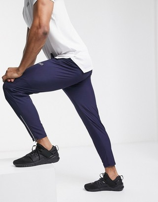 Asos 4505 4505 woven skinny tapered running sweatpants with reflective zip detail in navy