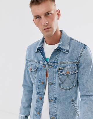 Wrangler distressed back print denim jacket in lightblue wash
