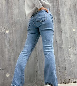 ASOS DESIGN Petite high rise '70's' kick flare jeans in midwash