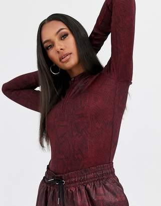 Nike burgundy snake print long sleeve bodysuit-Red