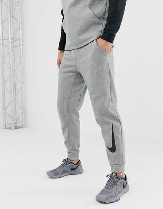 Nike Training Therma tapered swoosh joggers In grey
