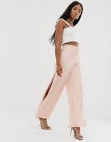 NA-KD Na Kd wide leg pants with side slit in pastel pink