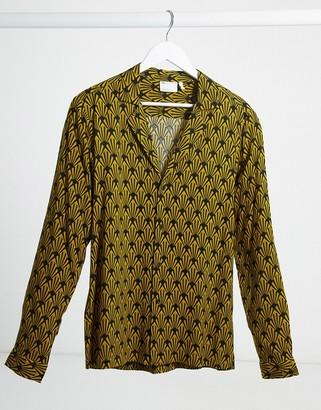 ASOS DESIGN regular fit deep revere shirt in monogram gold and black print