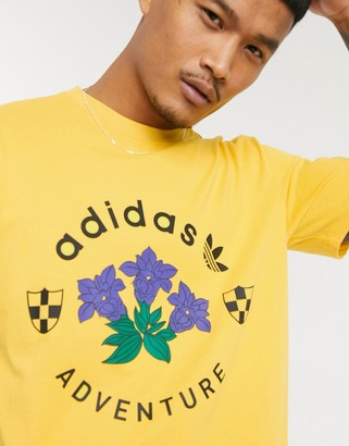 adidas t-shirt with adventure graphic print in gold
