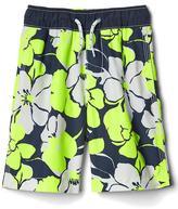 Neon hibiscus swim trunks