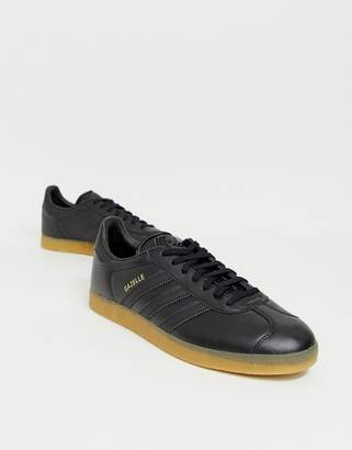 adidas gazelle trainers in black leather with gum sole