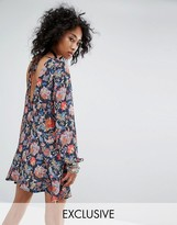 Reclaimed Vintage Long Sleeve Tunic Dress With Tie Back Detail In Floral Print