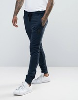 Religion Jersey Joggers In Slim Fit With Metal Badge And Zip Cuff