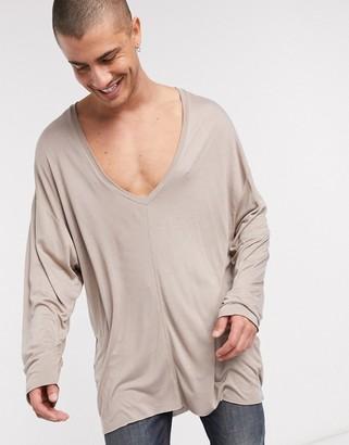 ASOS DESIGN viscose extreme oversized super longline deep v neck long sleeve t-shirt in beige