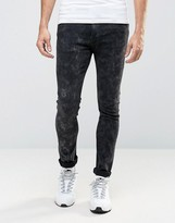 Asos Super Skinny Jeans With Random Bleaching In Black