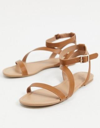 Call it SPRING Madona asymmetric flat sandals in tan