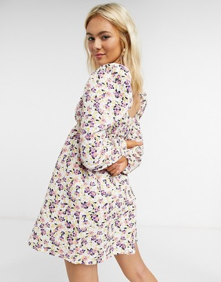 ASOS DESIGN textured smock mini dress with puff sleeve in pink and purple floral