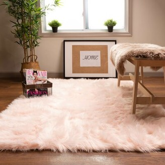 House of Hampton Charlotte Handmade Shag Faux Sheepskin Pink Area Rug Rug Size: Rectangle 4' x 6'