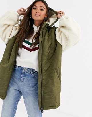 ASOS DESIGN quilted jacket with borg sleeves