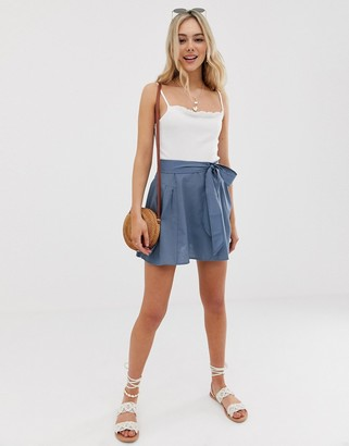 Asos DESIGN tie front mini skirt in cotton