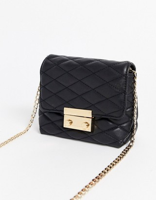 Lipsy quilted cross body bag with gold hardware in black