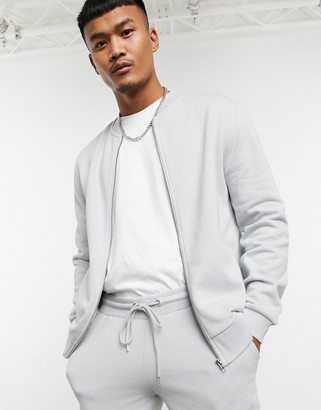 ASOS DESIGN tracksuit with bomber jacket in light gray