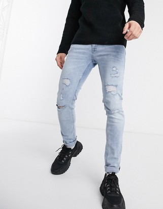 Jack and Jones Intelligence skinny fit super stretch abrasion jeans in light wash