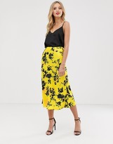 Asos Design DESIGN bias cut satin slip midi skirt in smudged yellow floral print