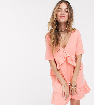 Asos DESIGN Petite Exclusive v front frill seam smock dress with tiered hem in coral