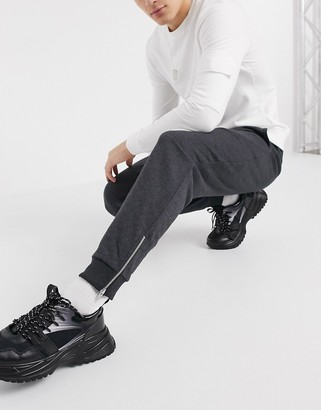 ASOS DESIGN organic tapered sweatpants in charcoal with silver zip cuffs