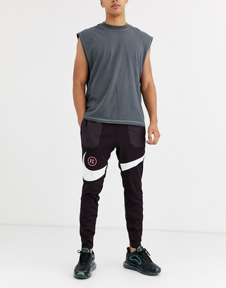 Nike Football F.C. swoosh joggers in burgundy-Red