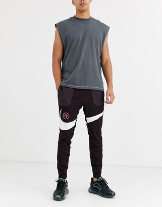 Nike Football Nike F.C. swoosh joggers in burgundy